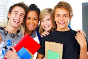 four teens in school hall
