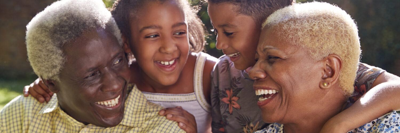 Senior black couple and grandchildren outdoors, close up