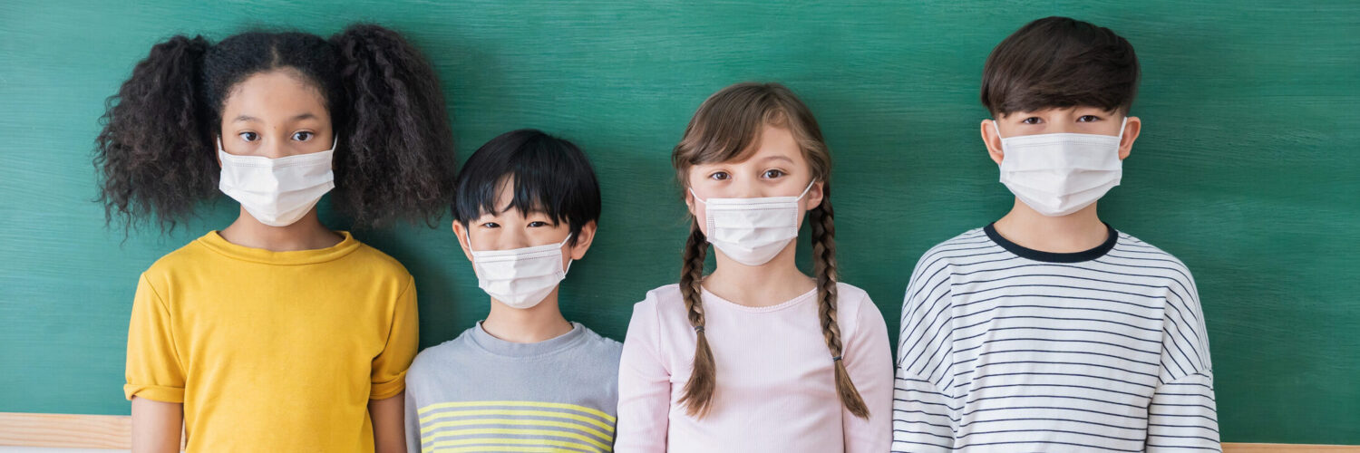 Portrait of group of international students wearing face mask, self-protection from corona virus pandemic. New normal children lifestyle, back to school concept